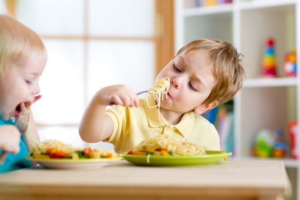 An Image of a Child Eating a Freshly Prepared Meal